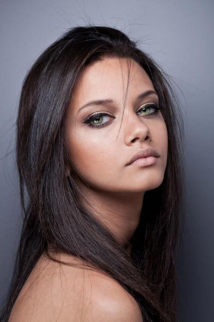 brown complexion, dark brown to black hair, green eyes, cat's eyes, Adriana Lima