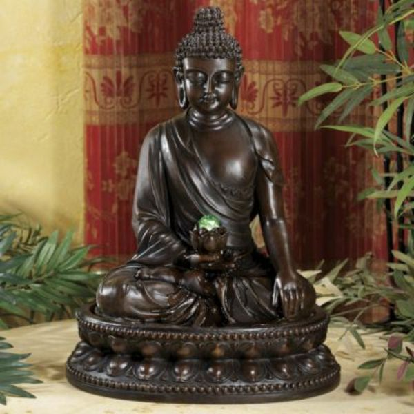 beautiful Buddha fountain-by-a-green-plant