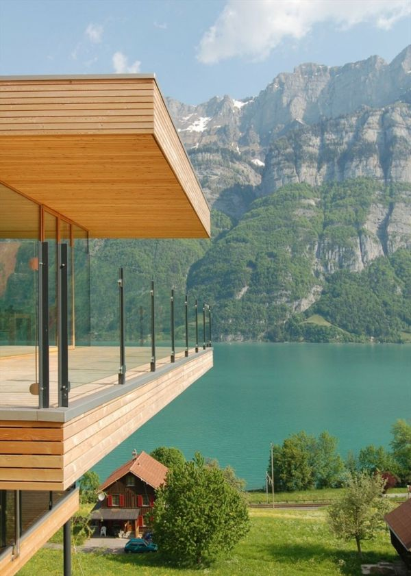 beautiful-residential-house-with-an-elegant-wooden terrace-view of the mountains